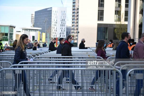 Stewards welcome spectators to Wembley Stadium ahead of the English FA Cup semi-final football match between Leicester City and Southampton at...