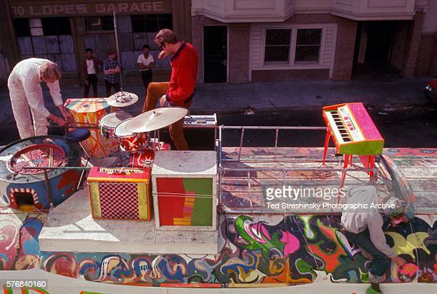 Stewart Brand and another member of the Merry Pranksters check the instruments on top of The Bus while Anthony Dean Wells known as the Hermit paints...