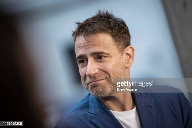 Stewart Butterfield, co-founder and chief executive officer of Slack, does a television interview outside the New York Stock Exchange , June 20, 2019...