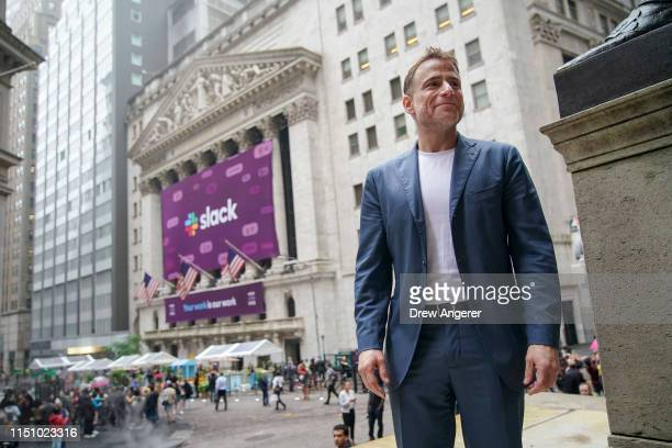 Stewart Butterfield, co-founder and chief executive officer of Slack, stands outside the New York Stock Exchange before the opening bell, June 20,...