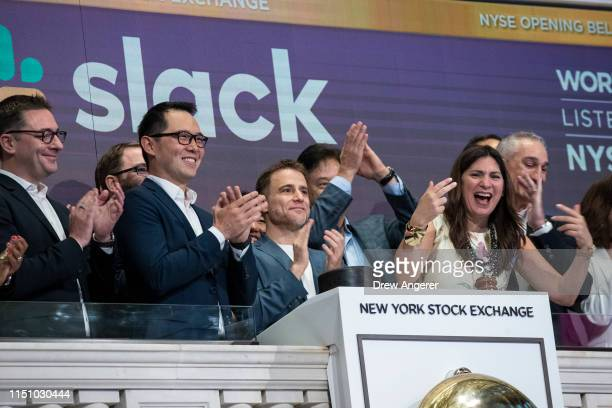 Stewart Butterfield , co-founder and chief executive officer of Slack, and Allen Shim , chief financial officer of Slack, ring the opening bell the...