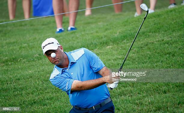 Stewart Cink of the United States plays a bunker shot on the ninth hole during the second round of THE PLAYERS Championship on The Stadium Course at...