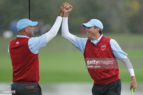 Stewart Cink of the USA celebrates with team mate Matt Kuchar on the 13th green during the Fourball & Foursome Matches during the 2010 Ryder Cup at...