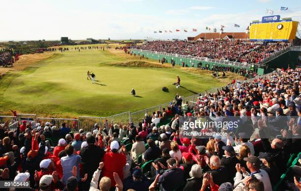 Stewart Cink of USA celebrates holing a birdie putt on the 18th green during the final round of the 138th Open Championship on the Ailsa Course,...