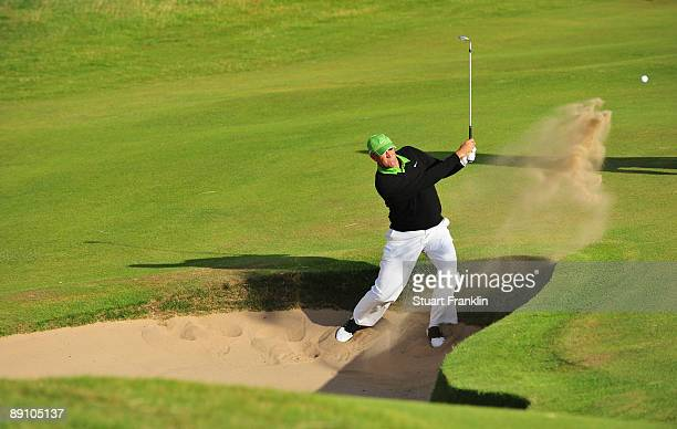 Stewart Cink of USA hits out of a bunker on the first play off hole during a play off following the final round of the 138th Open Championship on the...