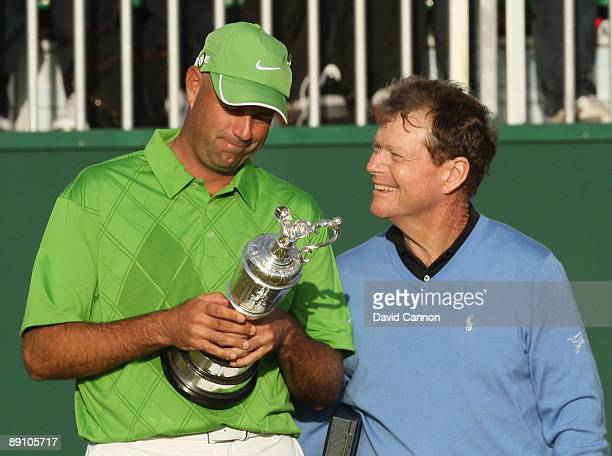 Stewart Cink of USA looks at the Claret Jug with Tom Watson of USA after his victory in a play off following the final round of the 138th Open...
