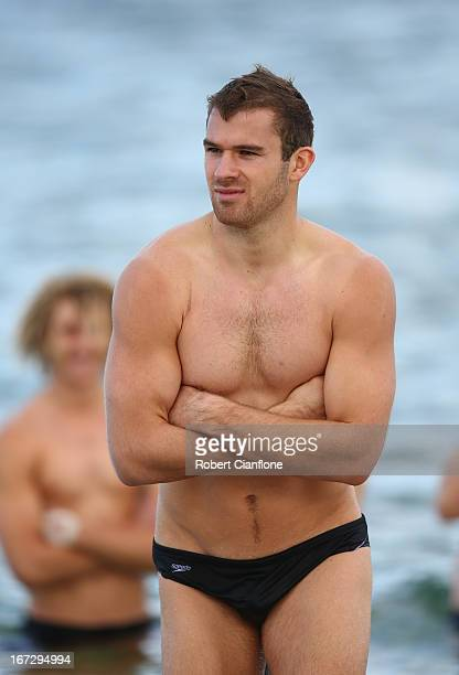 Stewart Crameri of the Bombers walks in the water during a Essendon Bombers recovery session at the St Kilda Sea Baths on April 24 2013 in Melbourne...