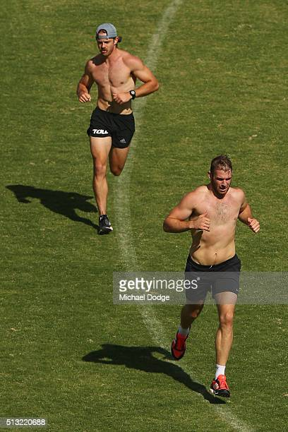 Stewart Crameri who played for the Western Bulldogs last season leads Travis Colyer in a 1km time trial during a training session at StBernard's...
