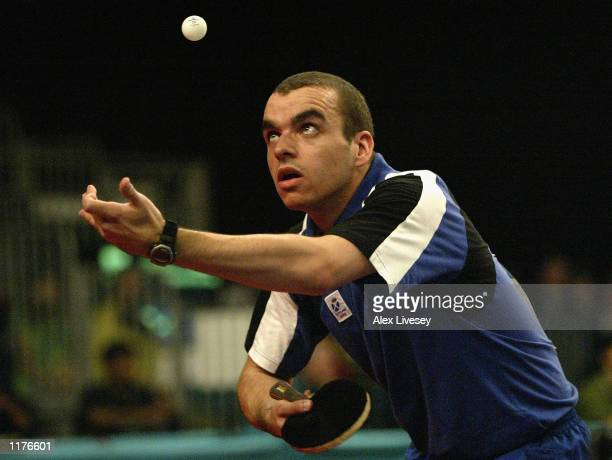 Stewart Crawford of Scotland serves during his match against Kevin Farley of Barbados during the Mens Team Table Tennis group matches at the Indoor...