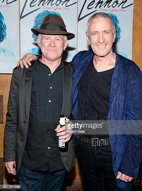 Stewart D'Arrietta and John R Waters attend the 'Lennon Through A Glass Onion' Opening Night After Party at Bar 13 on October 15 2014 in New York City