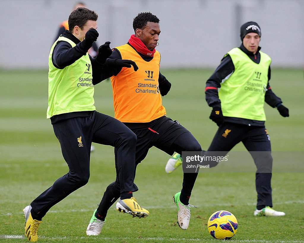 Stewart Downing and Daniel Sturridge of Liverpool in action during a training session at Melwood Training Ground on January 17, 2013 in Liverpool, England.