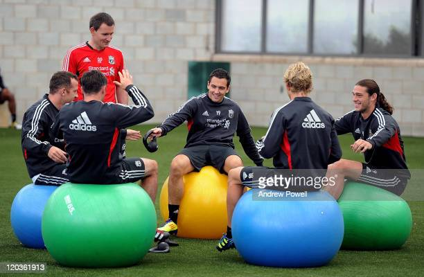 Stewart Downing Charlie Adam Andy Carroll Jamie Carragher and Dirk Kuyt of Liverpool in action during a Training session at Melwood Training Ground...