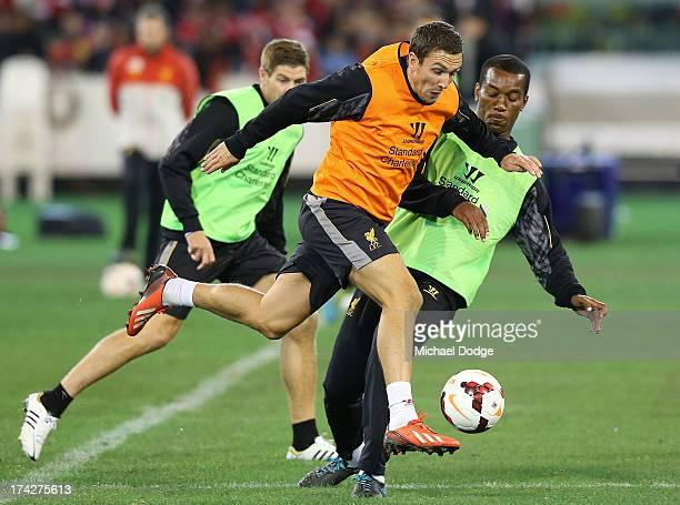 Stewart Downing kicks the ball past Andre Wisdom during a Liverpool FC training session at Melbourne Cricket Ground on July 23 2013 in Melbourne...