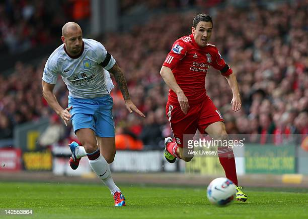 Stewart Downing of Liverpool beats Alan Hutton of Aston Villa during the Barclays Premier League match between Liverpool and Aston Villa at Anfield...