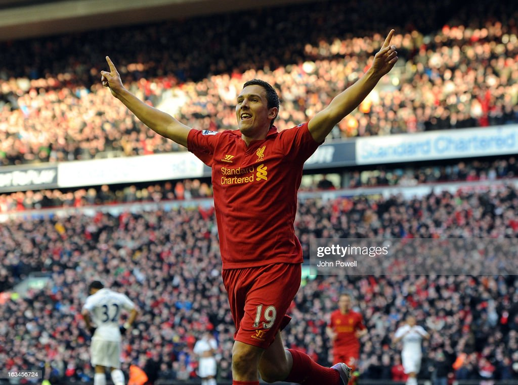Stewart Downing of Liverpool celebrates his goal during the Barclays Premier League match between Liverpool and Tottenham Hotspur at Anfield on March 10, 2013 in Liverpool, England.