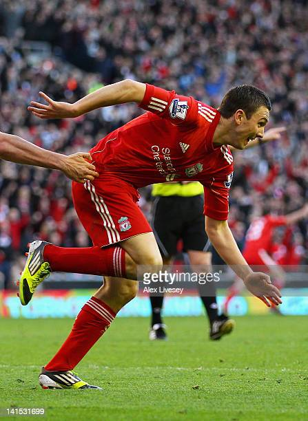 Stewart Downing of Liverpool celebrates his goal during the FA Cup with Budweiser Sixth Round match between Liverpool and Stoke City at Anfield on...