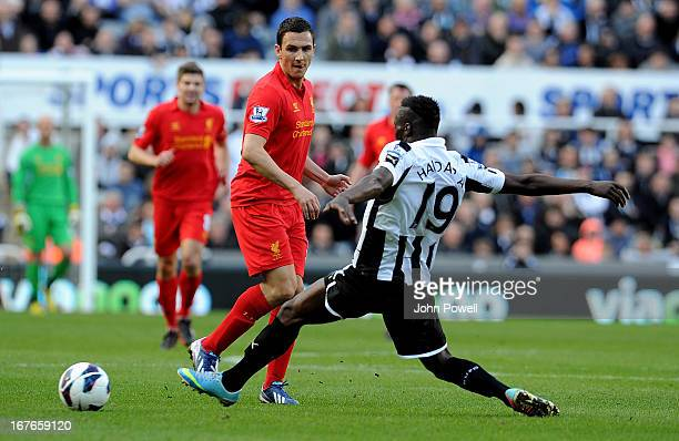 Stewart Downing of Liverpool competes ith Massadio Haidara of Newcastle United during the Barclays Premier League match between Newcastle United and...