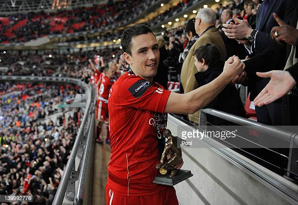 Stewart Downing of Liverpool holds the Hardaker man of the match trophy after the Carling Cup Final match between Liverpool and Cardiff City at...
