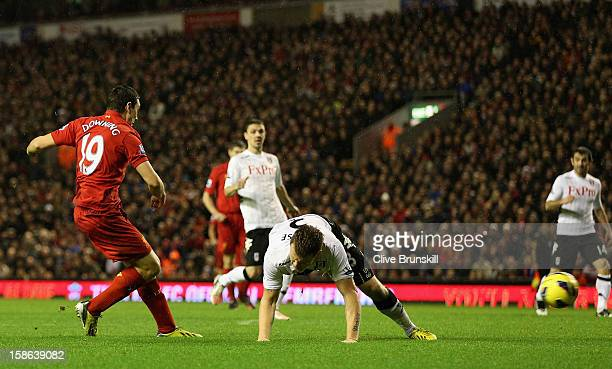 Stewart Downing of Liverpool scores his team's third goal during the Barclays Premier League match between Liverpool and Fulham at Anfield on...