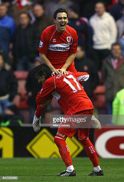 Stewart Downing of Middlesbrough celebrates with Tuncay Sanli after providing the cross for Afonso Alves to score the opening goal during the...