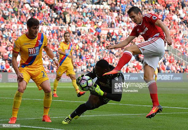 Stewart Downing of Middlesbrough challenges Steve Mandanda and Joel Ward of Crystal Palace during the Premier League match between Middlesbrough FC...
