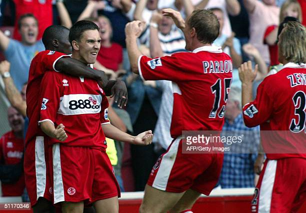 Stewart Downing of Middlesbrough is congratulated by teammates after his goal against Newcastle during their premier league football match 14 August...