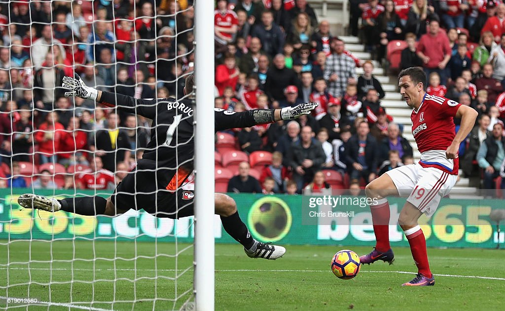Stewart Downing of Middlesbrough (R) scores his sides second goal past Artur Boruc of AFC Bournemouth (L) during the Premier League match between Middlesbrough and AFC Bournemouth at the Riverside Stadium on October 29, 2016 in Middlesbrough, England.