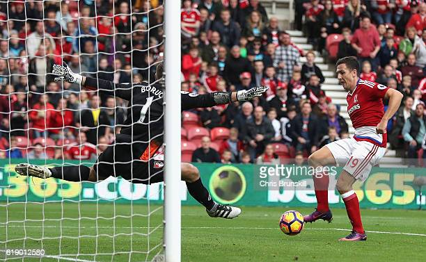Stewart Downing of Middlesbrough scores his sides second goal past Artur Boruc of AFC Bournemouth during the Premier League match between...