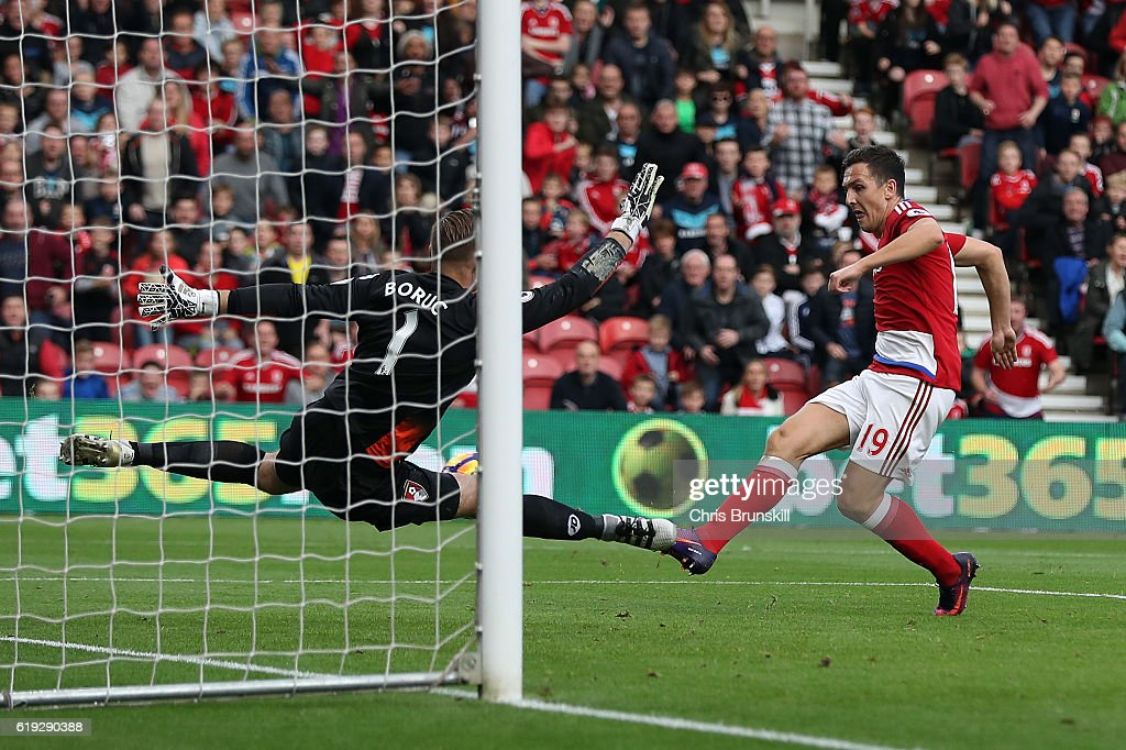 Stewart Downing of Middlesbrough (R) scores his sides second goal past Artur Boruc of AFC Bournemouth (L) during the Barclays Premier League match between Middlesbrough and AFC Bournemouth at the Riverside Stadium on October 29, 2016 in Middlesbrough, England.