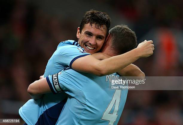 Stewart Downing of West Ham celebrates scoring his team's second goal with teammate Kevin Nolan during the Barclays Premier League match between...