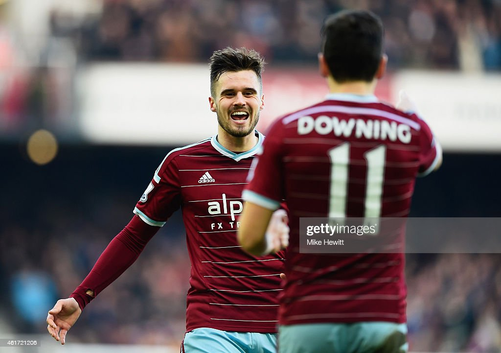 Stewart Downing of West Ham United (11) celebrates with team mate Carl Jenkinson as he scores their third goal during the Barclays Premier League match between West Ham United and Hull City at Boleyn Ground on January 18, 2015 in London, England.