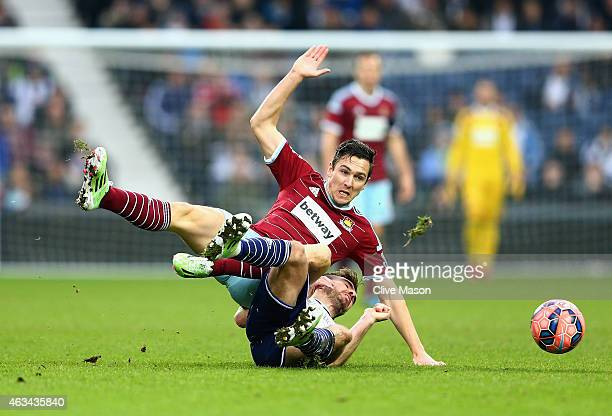Stewart Downing of West Ham United is challenged by James Morrison of West Bromwich Albion during the FA Cup Fifth Round match between West Bromwich...