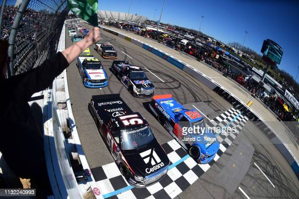 Stewart Friesen driver of the Halmar International Chevrolet and Kyle Busch driver of the Cessna Toyota lead the field to the green flag to start the...