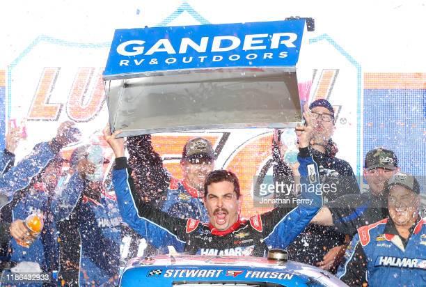 Stewart Friesen, driver of the Halmar International Chevrolet, celebrates in victory lane after winning the NASCAR Gander Outdoors Truck Series Lucas...