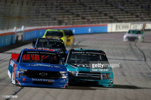 Stewart Friesen driver of the Halmar International Chevrolet leads a pack of trucks during the NASCAR Gander Outdoors Truck Series Vankor 350 at...