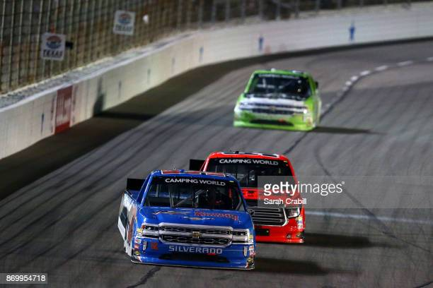 Stewart Friesen driver of the Halmar International Chevrolet leads a pack of trucks during the NASCAR Camping World Truck Series JAG Metals 350...