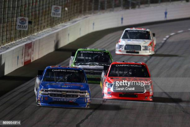 Stewart Friesen driver of the Halmar International Chevrolet leads Regan Smith driver of the BTS Tire Wheel/Advance Auto Parts Ford during the NASCAR...