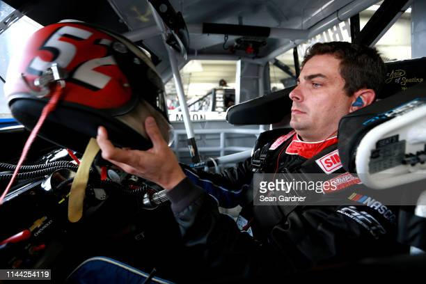 Stewart Friesen driver of the Halmar International Chevrolet sits in his truck during practice for the NASCAR Gander Outdoors Truck Series North...