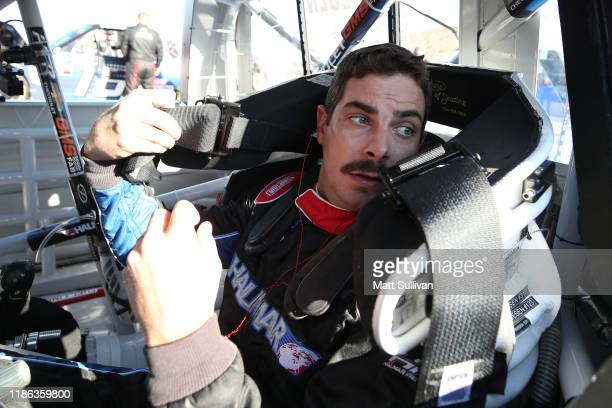 Stewart Friesen driver of the Halmar International Chevrolet sits in his truck during practice for the NASCAR Gander Outdoors Truck Series Lucas Oil...