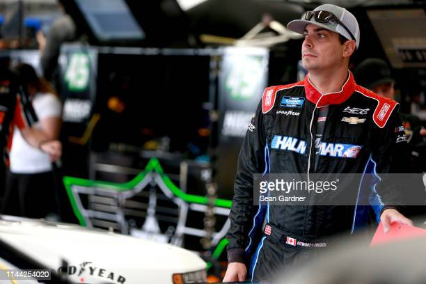 Stewart Friesen driver of the Halmar International Chevrolet stands in the garage during practice for the NASCAR Gander Outdoors Truck Series North...