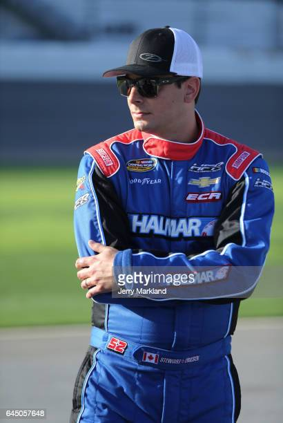 Stewart Friesen driver of the Halmar International Chevrolet stands on the grid during qualifying for the NASCAR Camping World Truck Series NextEra...