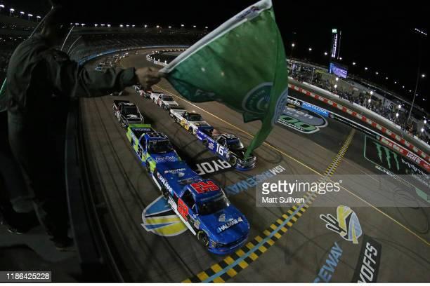 Stewart Friesen, driver of the Halmar International Chevrolet, takes the green flag to start the NASCAR Gander Outdoors Truck Series Lucas Oil 150 at...