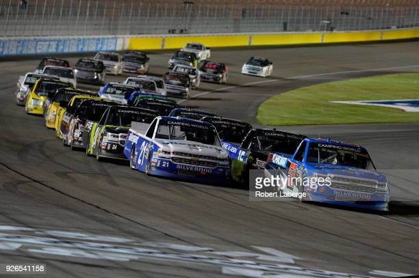 Stewart Friesen driver of the We Build America Chevrolet and Johnny Sauter driver of the Allegiant Airlines Chevrolet lead the field to green during...