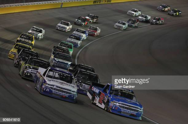 Stewart Friesen driver of the We Build America Chevrolet and Johnny Sauter driver of the Allegiant Airlines Chevrolet lead the field during the...