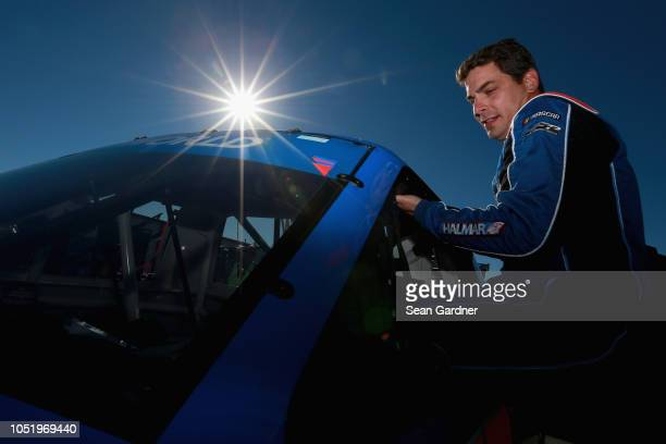 Stewart Friesen driver of the We Build America Chevrolet get into his truck during practice for the Camping World Truck Series Fr8Auctions 250 at...