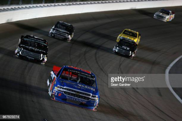 Stewart Friesen driver of the We Build America Chevrolet leads a pack of trucks during the NASCAR Camping World Truck Series 37 Kind Days 250 at...