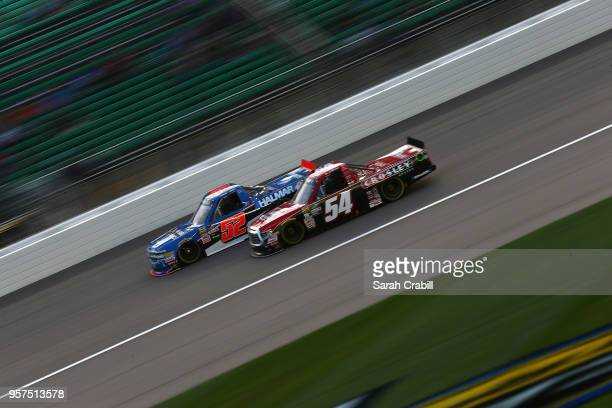 Stewart Friesen driver of the We Build America Chevrolet leads Bo LeMastus driver of the Crosley Brands/DGR Crosley Toyota during the NASCAR Camping...