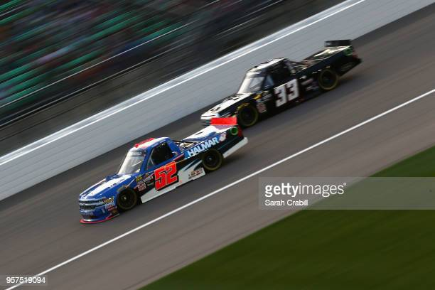 Stewart Friesen driver of the We Build America Chevrolet leads Josh Reaume driver of the Colonial Countertops Toyota during the NASCAR Camping World...