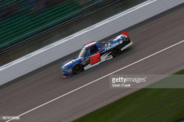 Stewart Friesen driver of the We Build America Chevrolet races during the NASCAR Camping World Truck Series 37 Kind Days 250 at Kansas Speedway on...