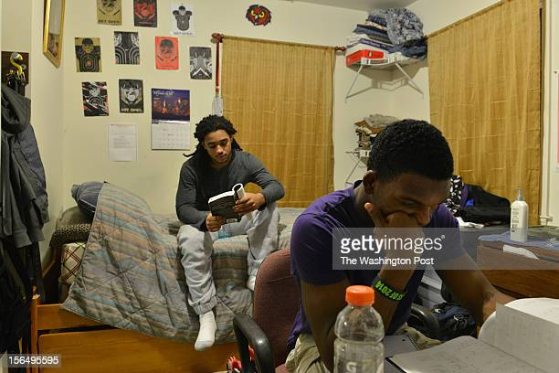J Stewart front and Arturo Brown study for their high school classes at the home of Stewart on Wednesday November 14 in Arlington VA Yorktown running...